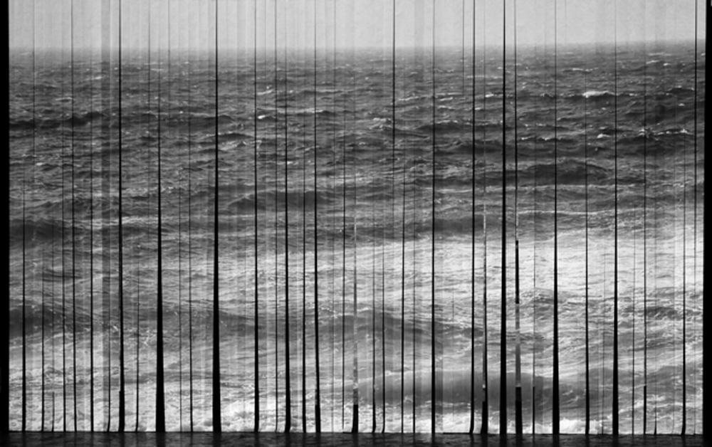 DEREK KRECKLER, Littoral, Single channel video installation, paper-strip screen, electric fan, 2014